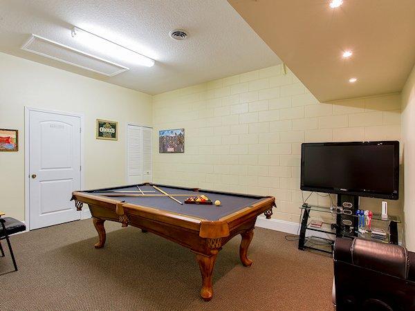 "Games room full-size pool table-48"" HDTV"