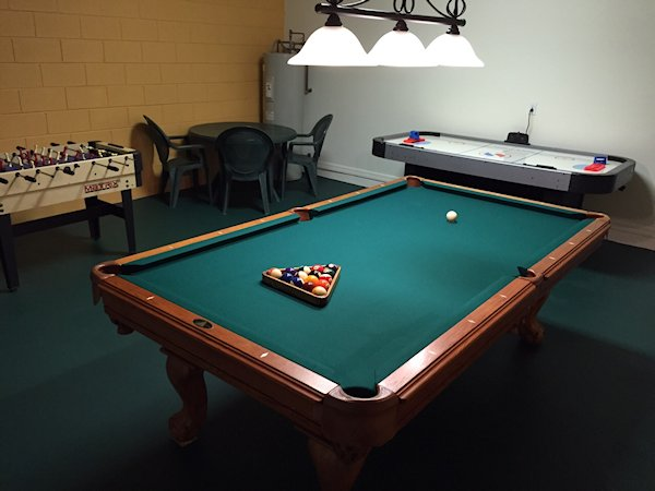8ft slate pool table, 7ft air hockey table, foosball table