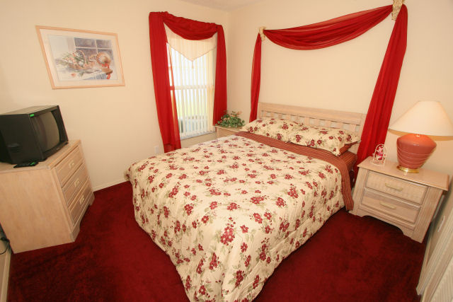 bedroom two with air con , cable tv , walk in wardrobe