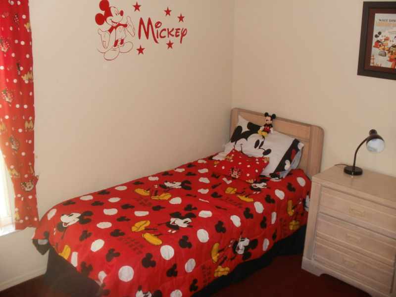 Disney room with air con , toddler bed guards and crib