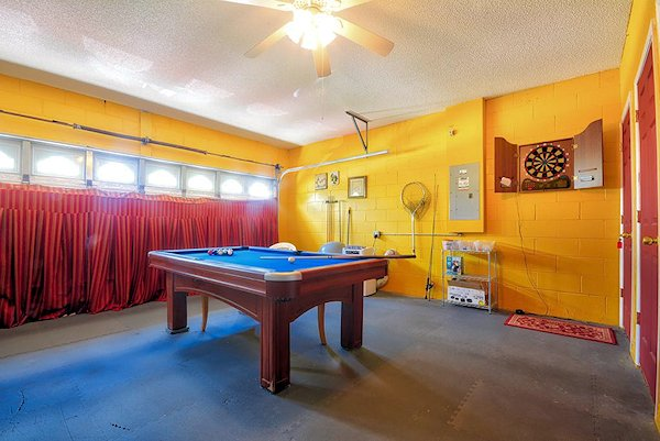 Air conditioned games room with pool, darts and fishing gear