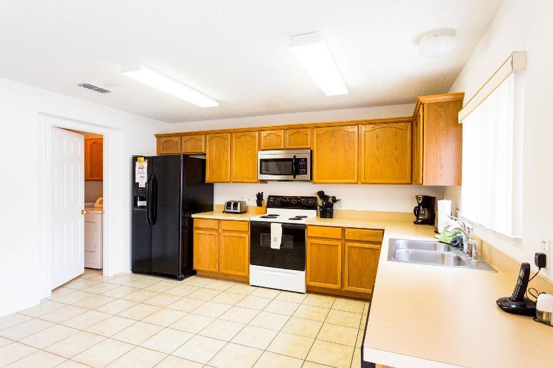 Kitchen with dishwasher, washing machine, tumble dryer,